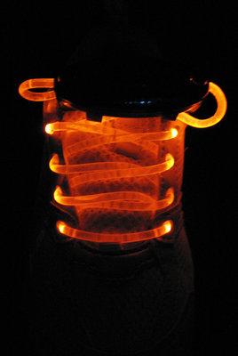 Oranje lichtgevende led veters